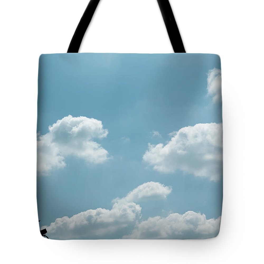 Recreational Pursuit Tote Bag featuring the photograph Cyclists Silhouettes by Zmeel