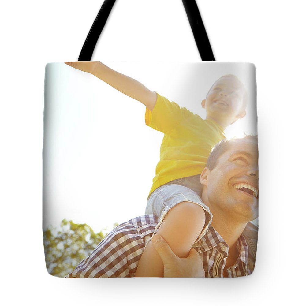 Human Arm Tote Bag featuring the photograph Dad Makes Me Feel Like I Can Fly by Gradyreese