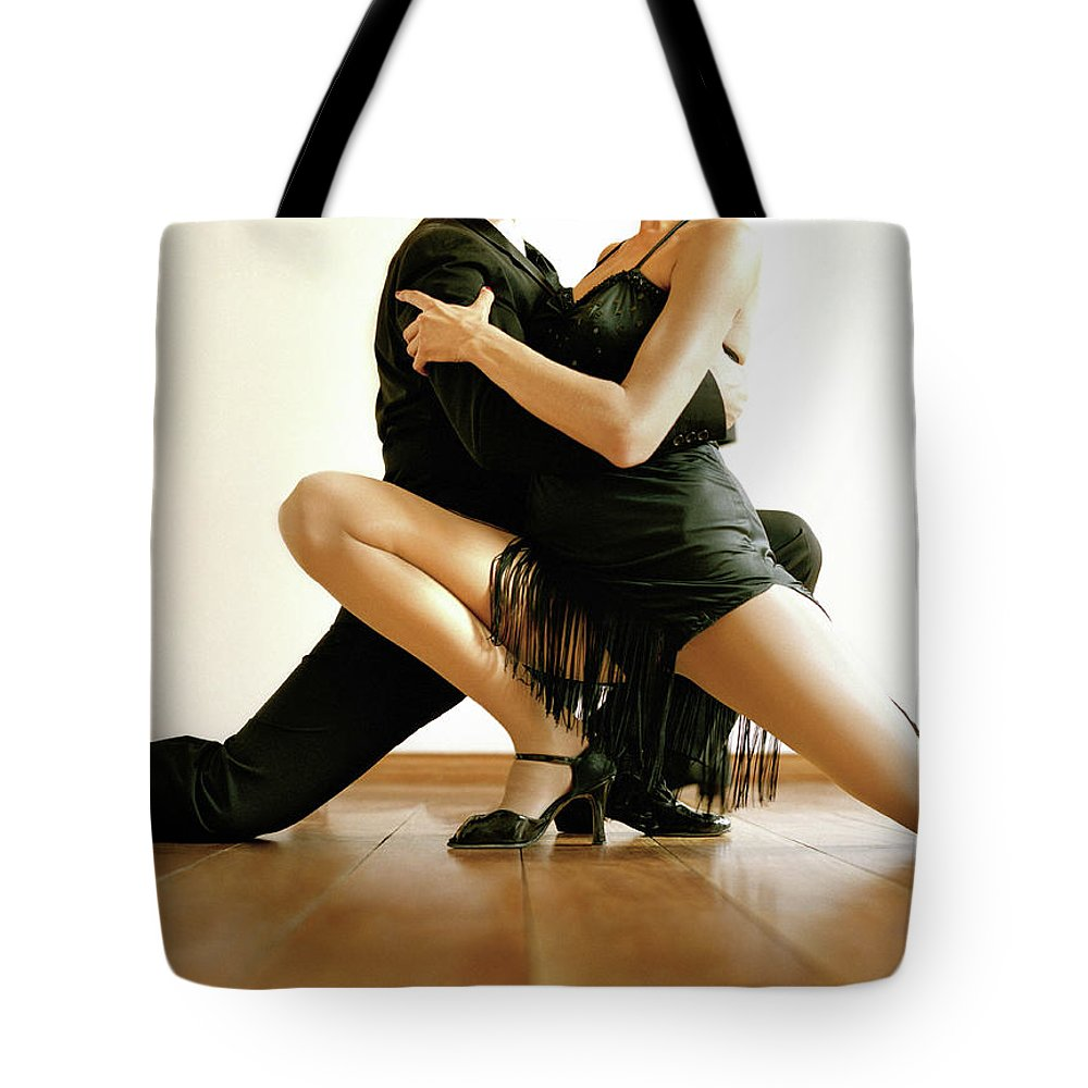 Heterosexual Couple Tote Bag featuring the photograph Dancers In Tango Position, Low Section by David Sacks