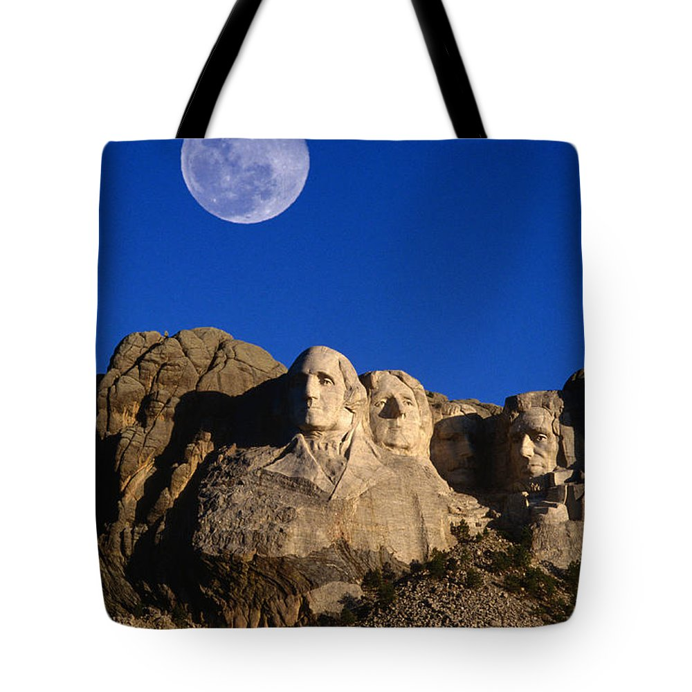 Mt Rushmore National Monument Tote Bag featuring the photograph Daytime Moon Above Presidential Faces by Mark Newman