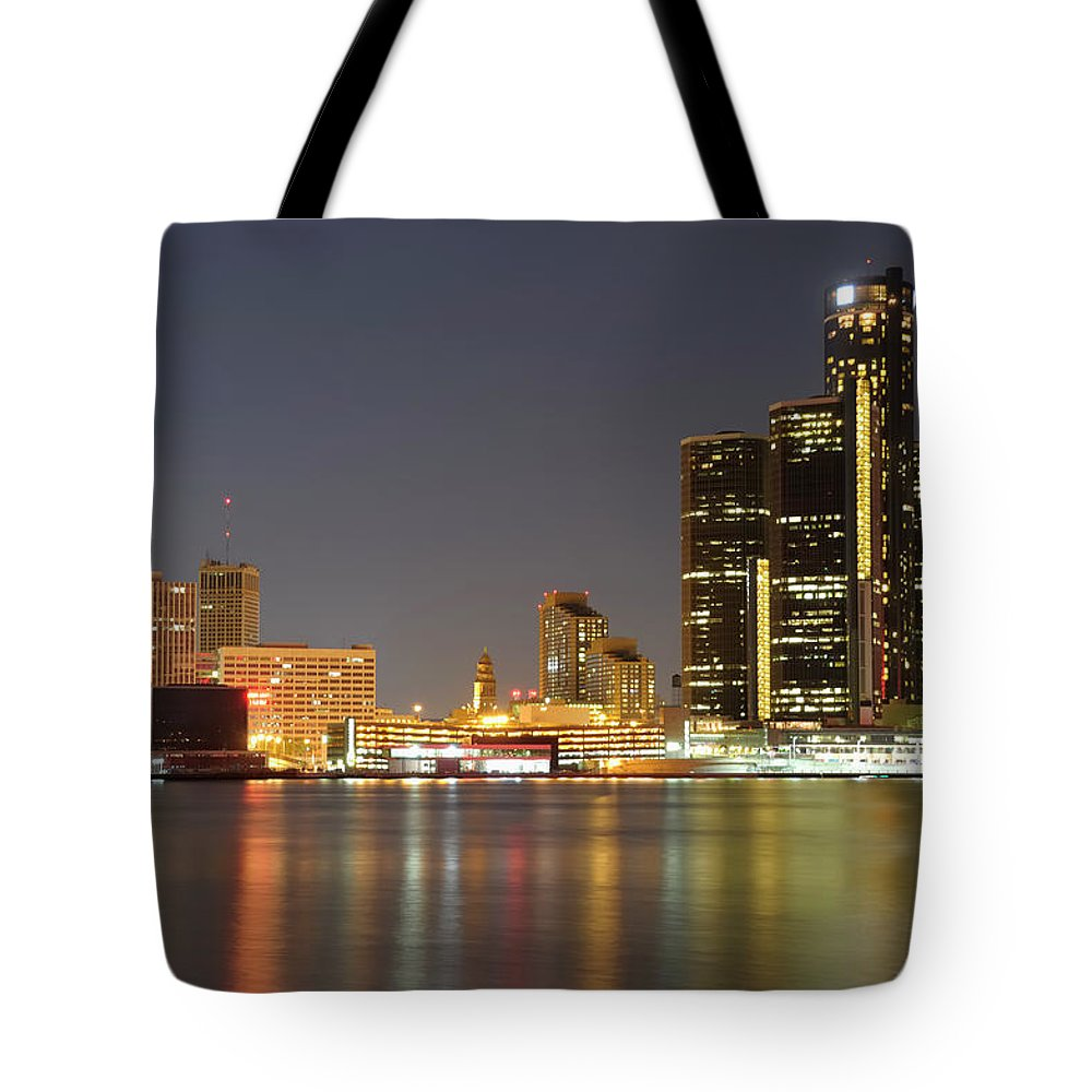 Downtown District Tote Bag featuring the photograph Detroit Skyline At Night by Rivernorthphotography