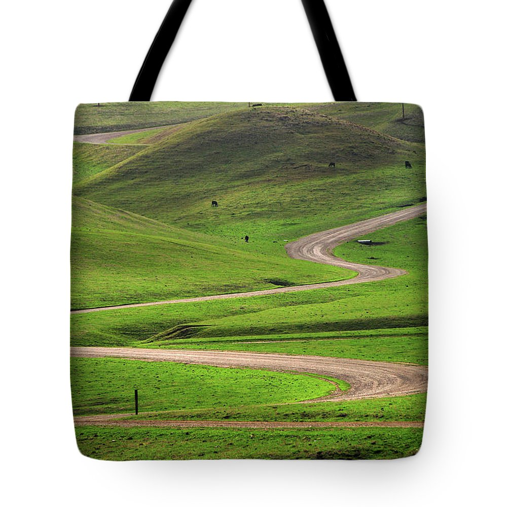 Tranquility Tote Bag featuring the photograph Dirt Road Through Green Hills by Mitch Diamond