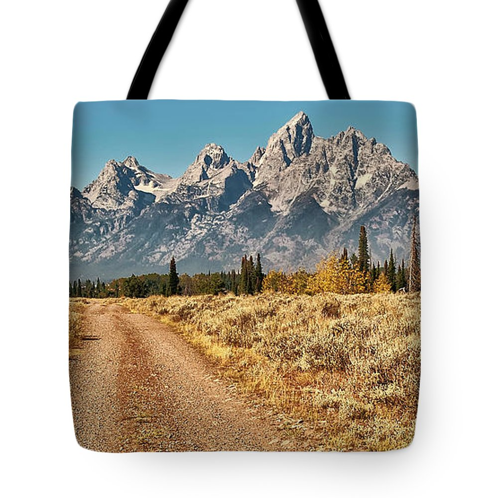 Tranquility Tote Bag featuring the photograph Dirt Road To Tetons by Jeff R Clow