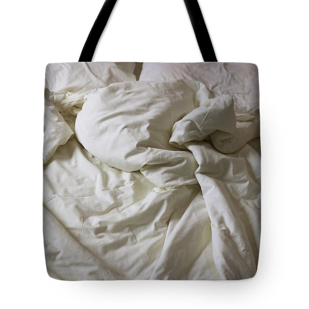 Hotel Tote Bag featuring the photograph Discarded Bed, Early Morning by Julio Lopez Saguar