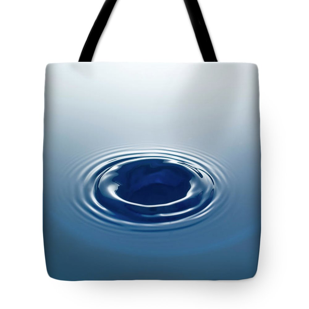 Motion Tote Bag featuring the photograph Drop by Stockcam