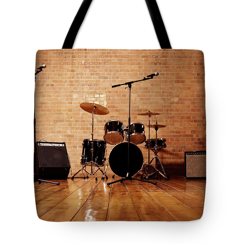 Microphone Stand Tote Bag featuring the photograph Drum Kit, Microphones And Loudspeakers by Digital Vision.