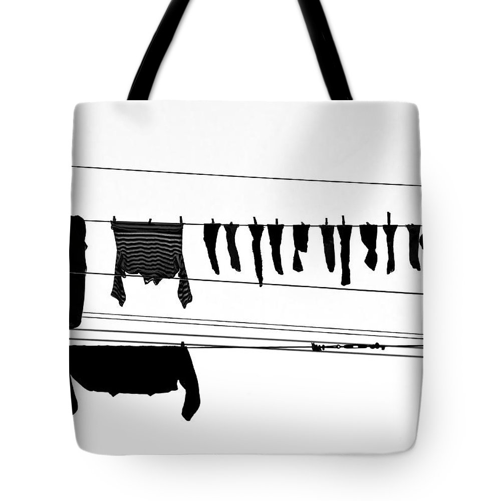 Hanging Tote Bag featuring the photograph Drying Laundry On Two Clothesline by Massimo Strazzeri Photography