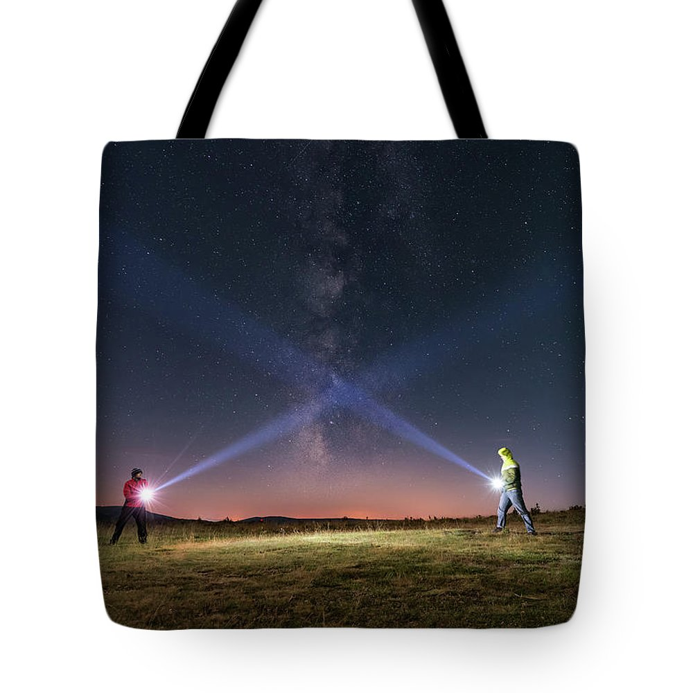 People Tote Bag featuring the photograph Duel Of Light by Carlos Fernandez
