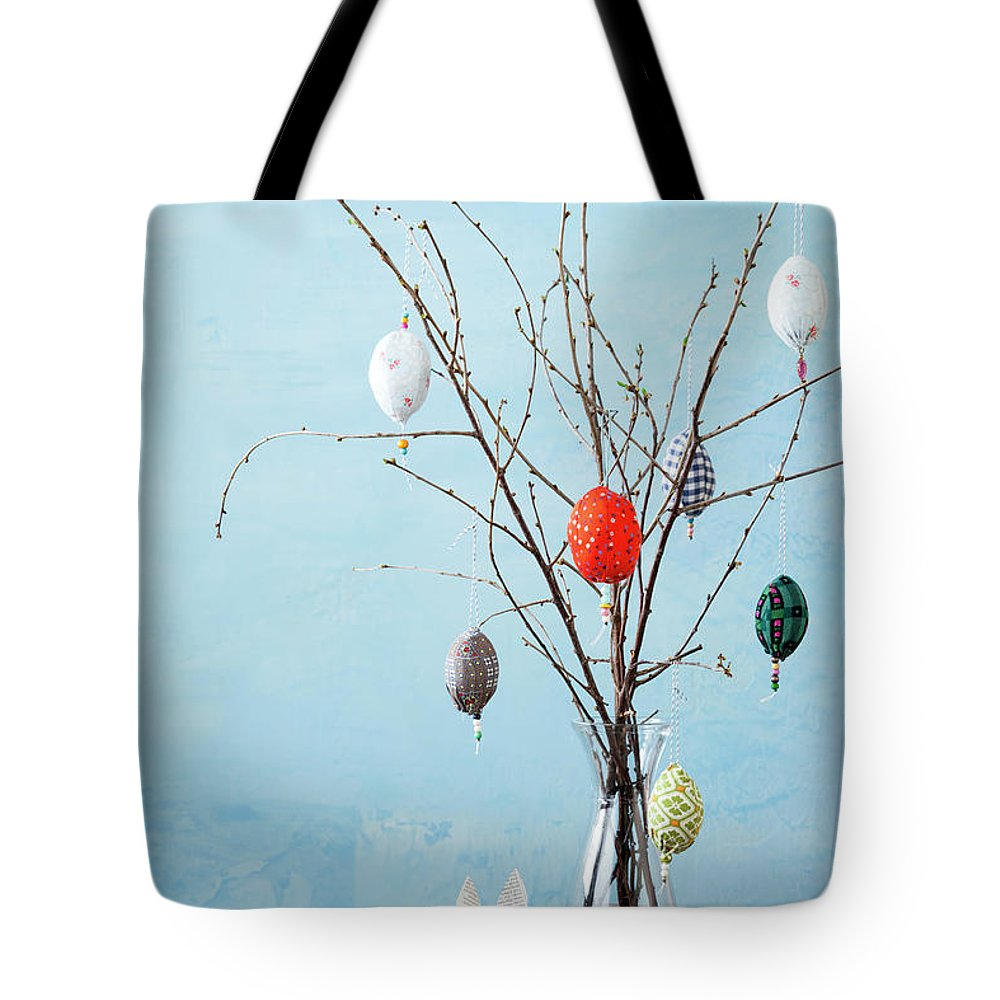 Holiday Tote Bag featuring the photograph Egg-shaped Decorations On Branches by Stefanie Grewel
