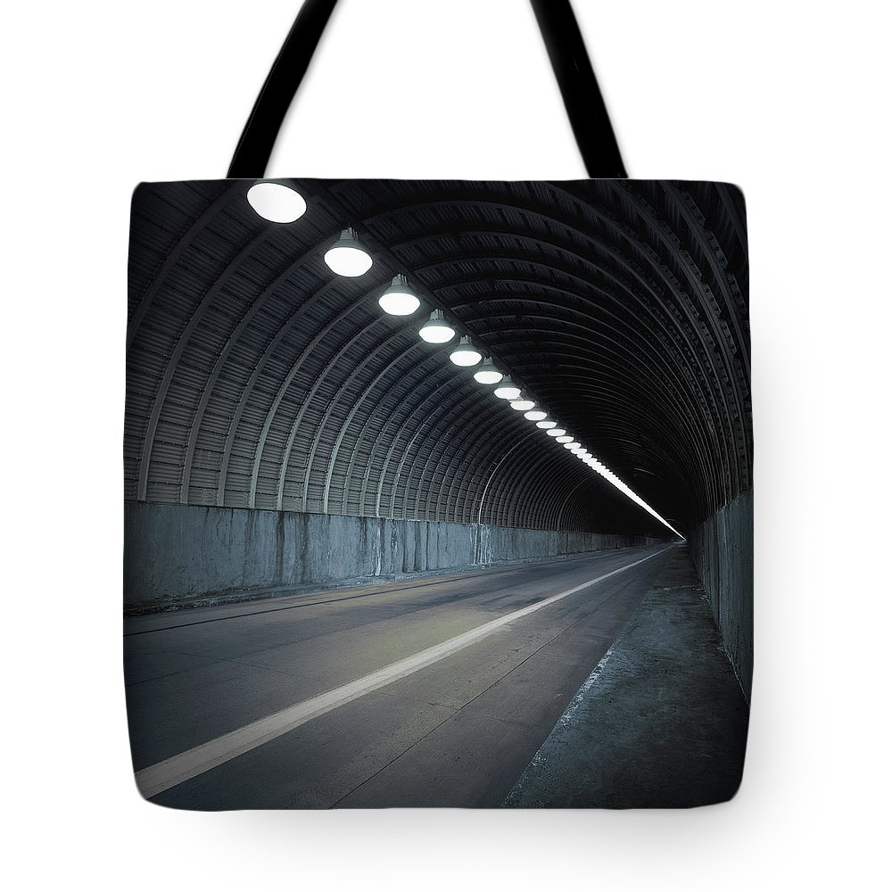 Empty Tote Bag featuring the photograph Empty Tunnel With Lights Digital by Ed Freeman