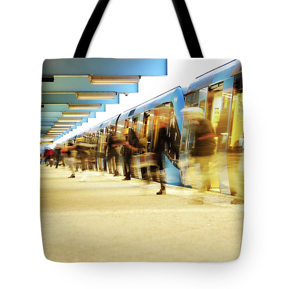 Crowd Tote Bag featuring the photograph Exiting Subway Train by Olaser
