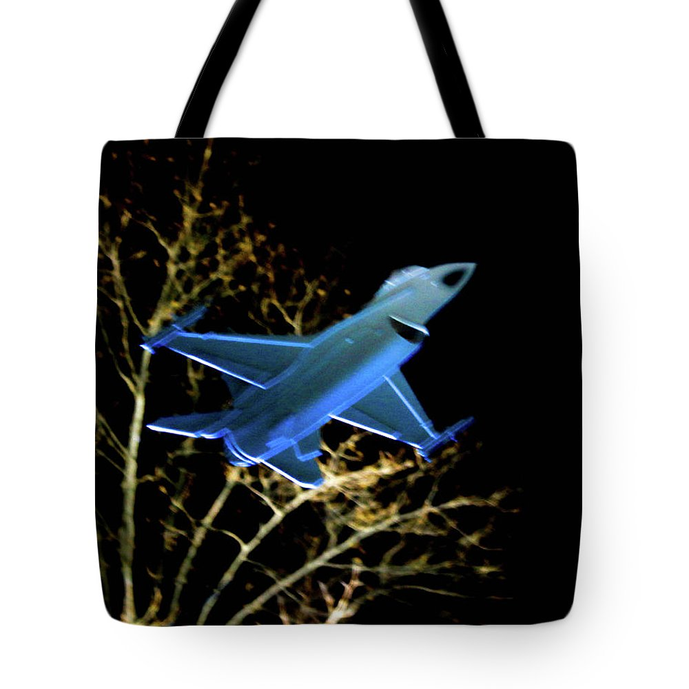 This Is A Photo Of One Of The F 16 Fighter Jets On The Glass Monument At The Air Force Memorial At Night Tote Bag featuring the photograph F 16 Lit Up At Night On Glass Monument by William Rogers