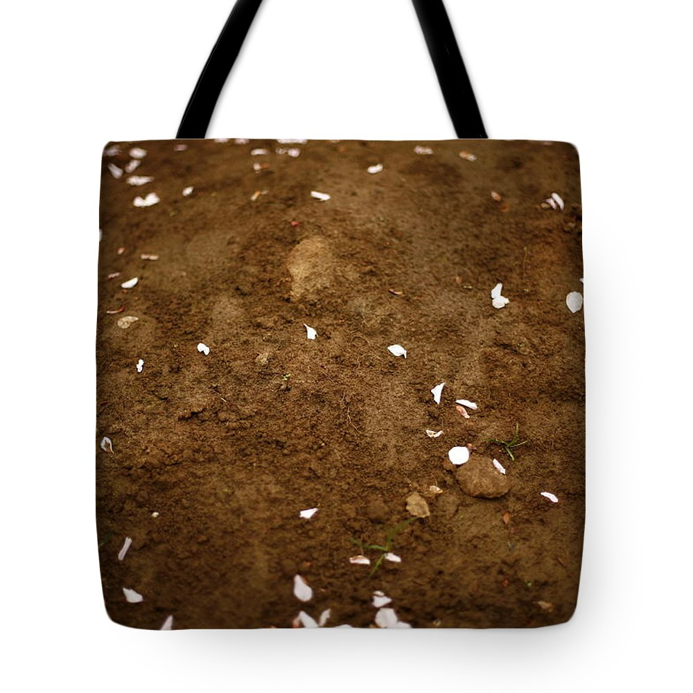 Outdoors Tote Bag featuring the photograph Fallen Apple Blossoms On Mound Of Soil by Matt Niebuhr
