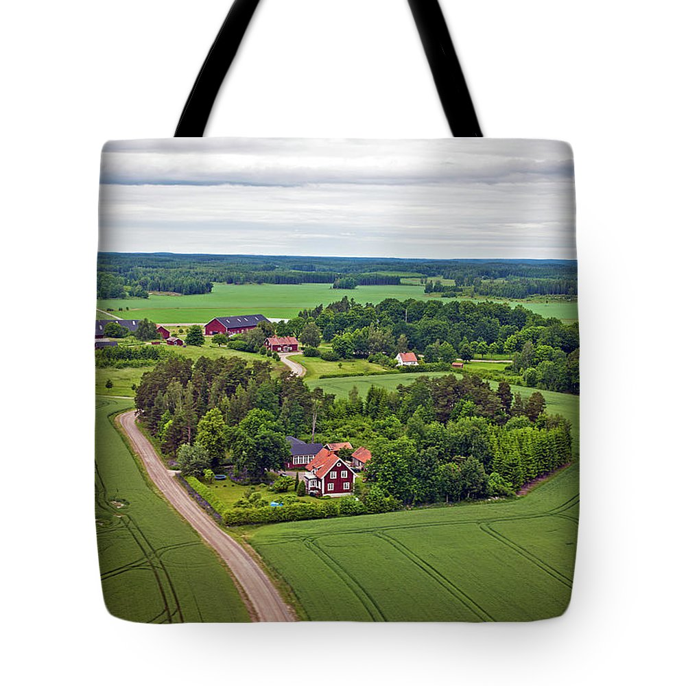 Scenics Tote Bag featuring the photograph Farms And Fields In Sweden North Europe by Pavliha