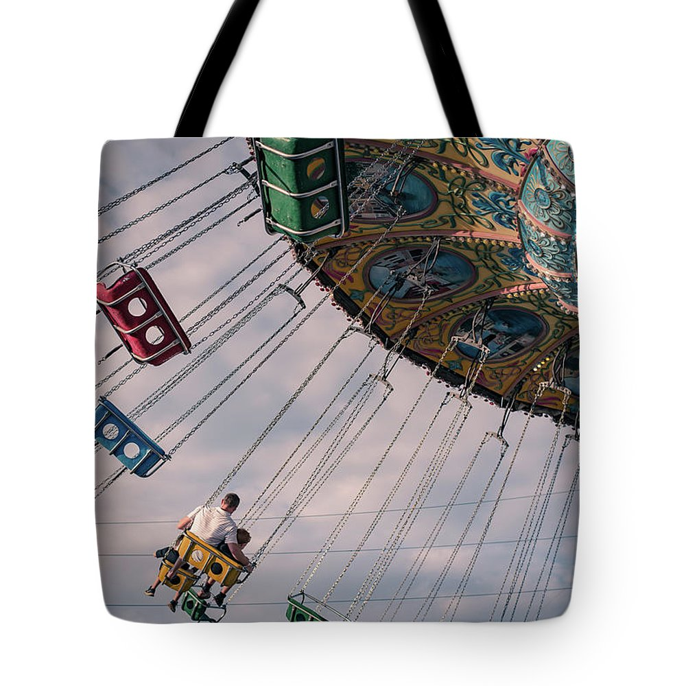 Vacation Tote Bag featuring the photograph Father And Son On The Swings by Anthony Doudt