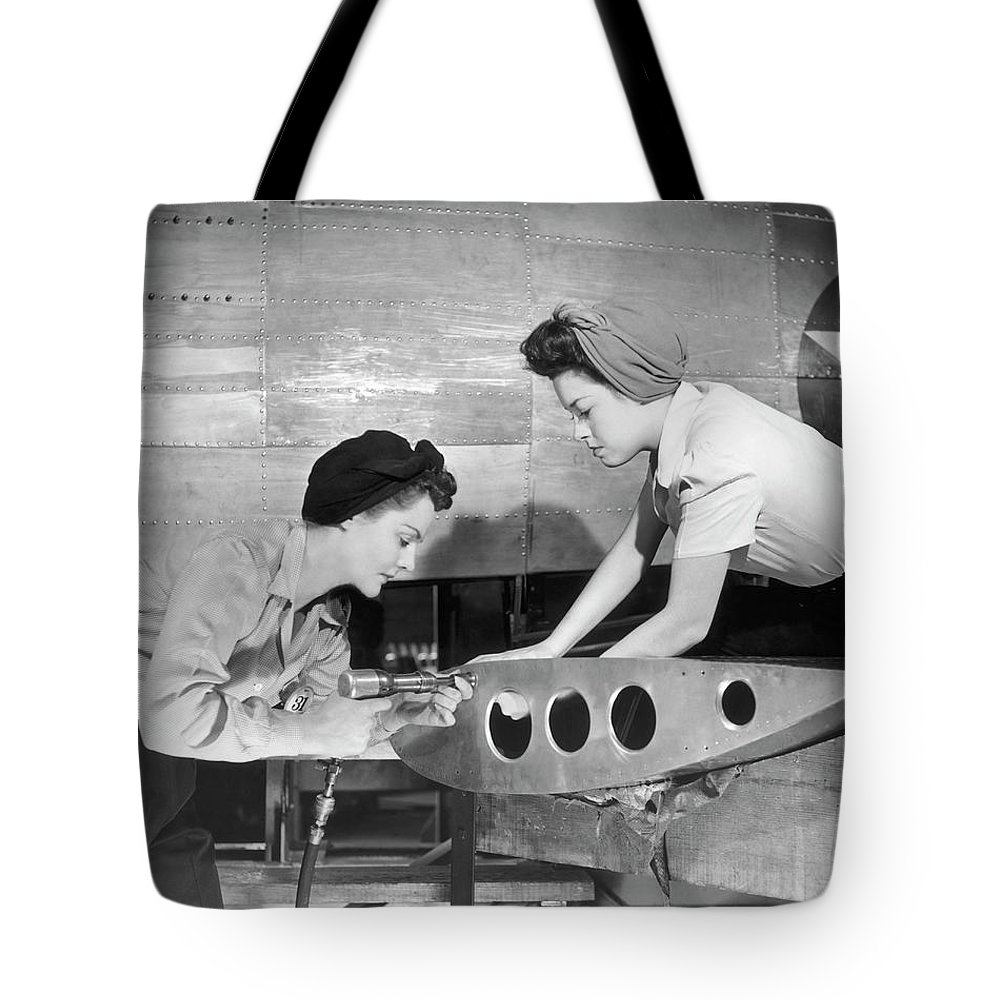 Working Tote Bag featuring the photograph Female Workers Working On Plane by George Marks