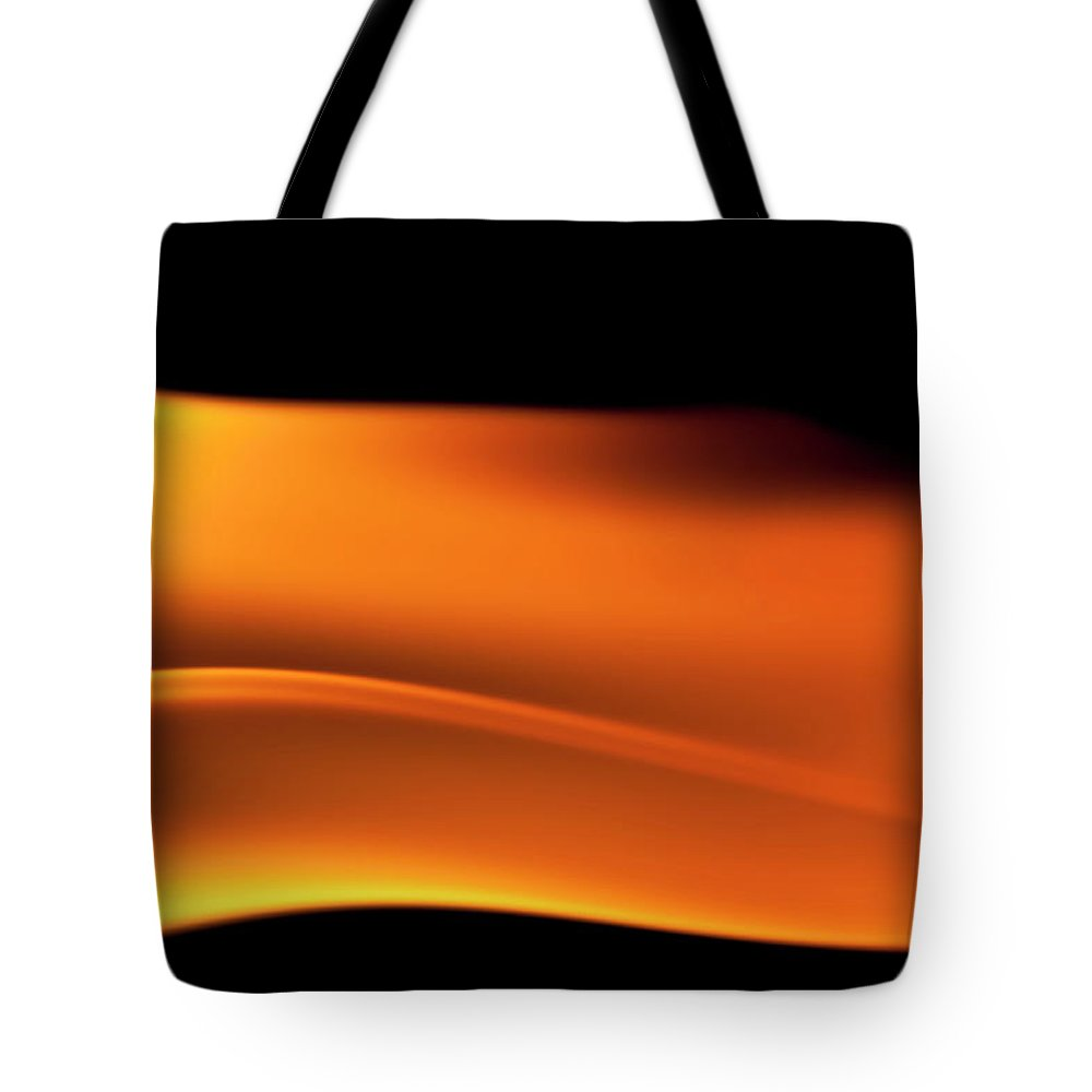 Orange Color Tote Bag featuring the photograph Fire Burning, Flames On Black Background by Tttuna