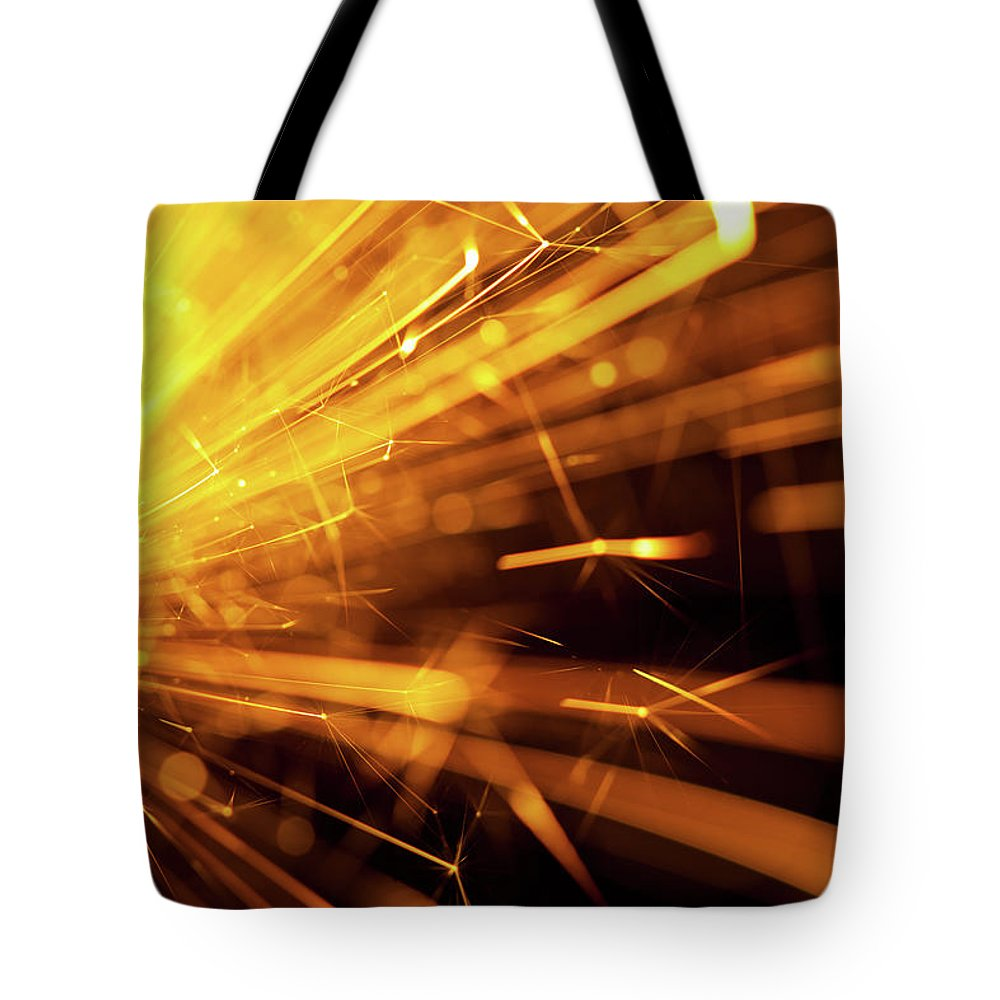 Funky Tote Bag featuring the photograph Fire Sparkler by Nikada