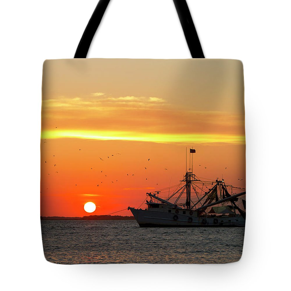 Water's Edge Tote Bag featuring the photograph Fishing Boat At Sunset by Tshortell