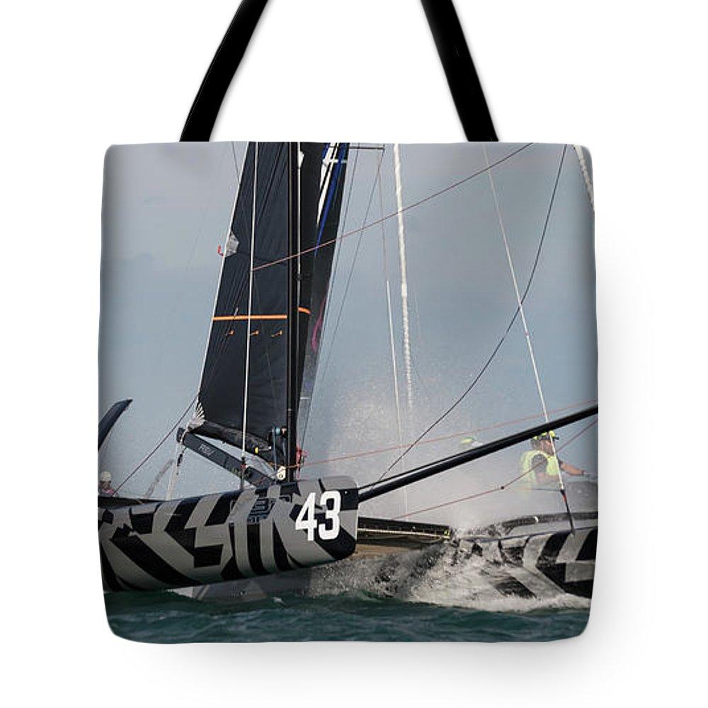 M32 Tote Bag featuring the photograph Fleet Feet by Steven Lapkin