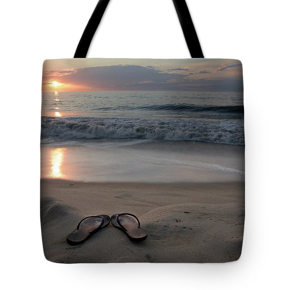 Water's Edge Tote Bag featuring the photograph Flip-flops On The Beach by Sdominick