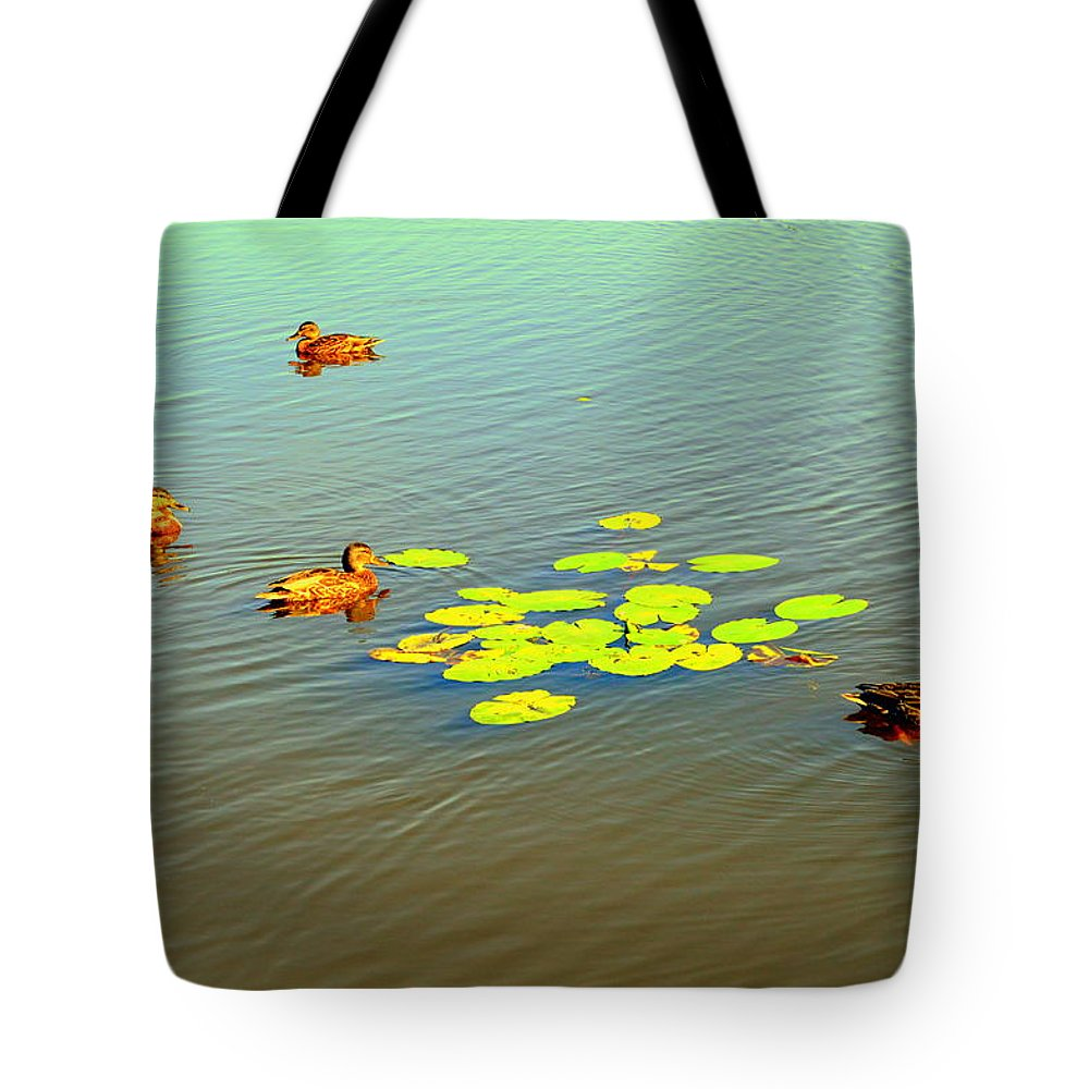 Henryk Tote Bag featuring the photograph Floating Ducks by Henryk Gorecki