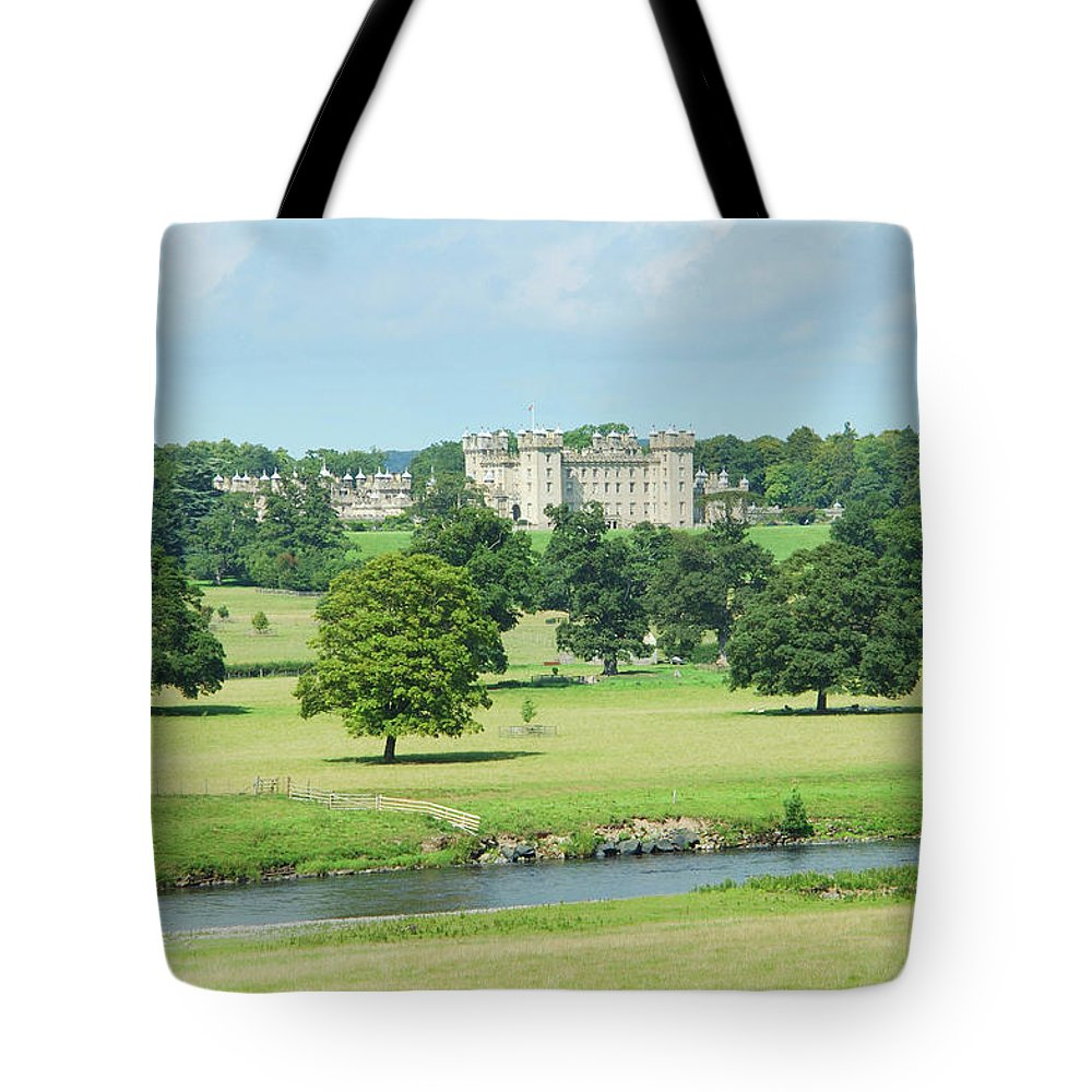 Floors Castle Tote Bag featuring the photograph Floors Castle And River Tweed by Victor Lord Denovan