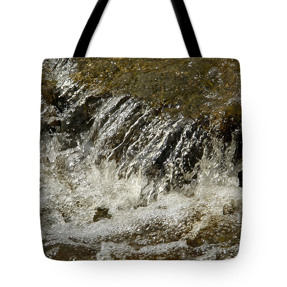 Water Tote Bag featuring the photograph Flowing Water Over Rocks by Victor Lord Denovan