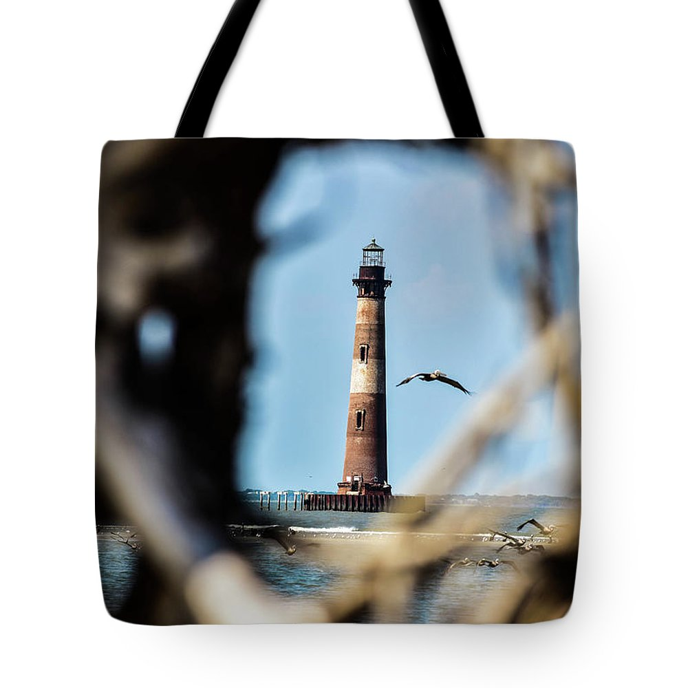 Lighthouse Tote Bag featuring the photograph Fly By by Leslie and Mitch Anderson