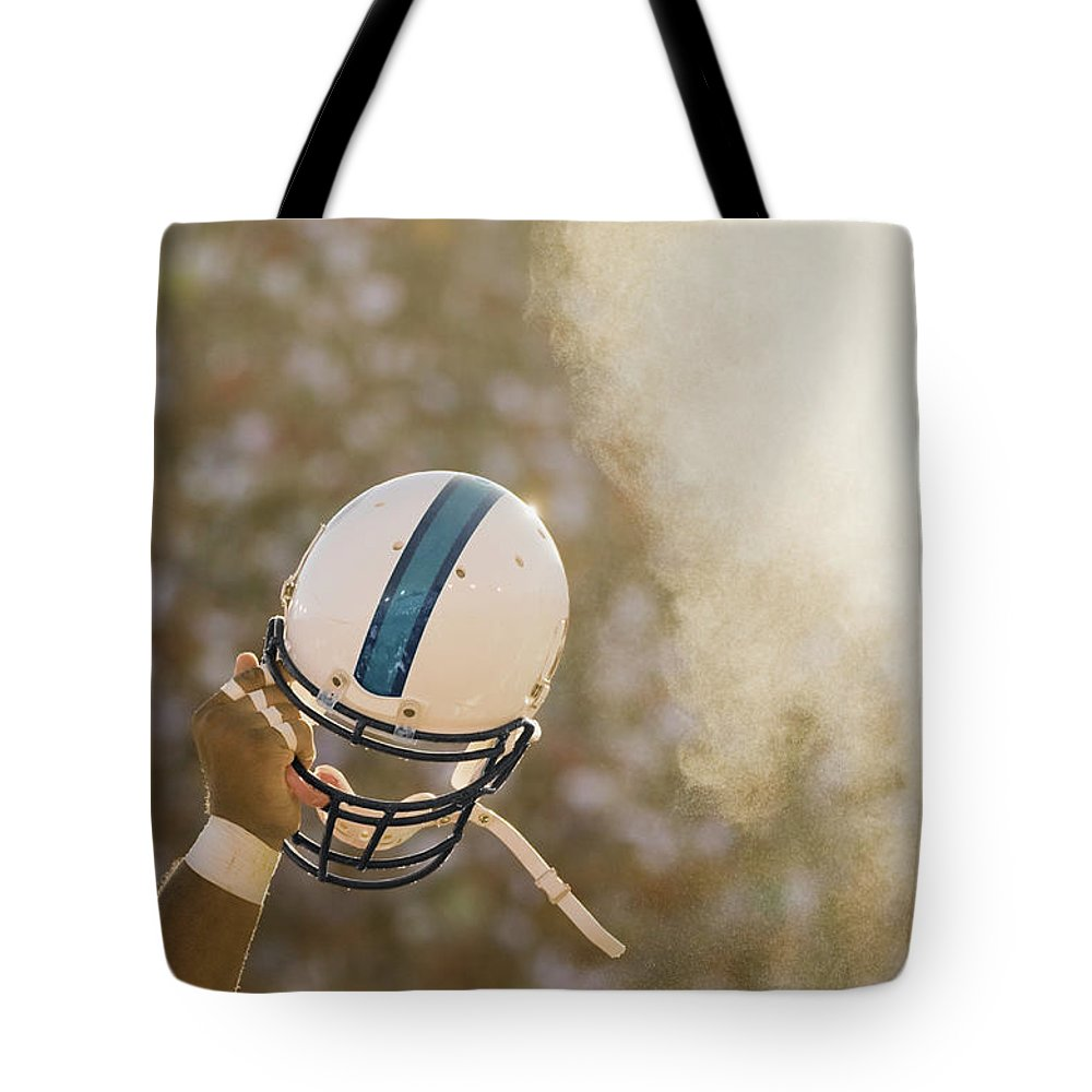 Celebration Tote Bag featuring the photograph Football Player Waving Helmet In Air by David Madison