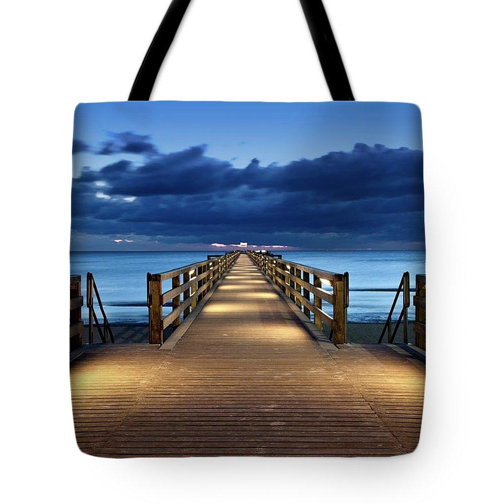 Water's Edge Tote Bag featuring the photograph Footbridge by Bertlmann