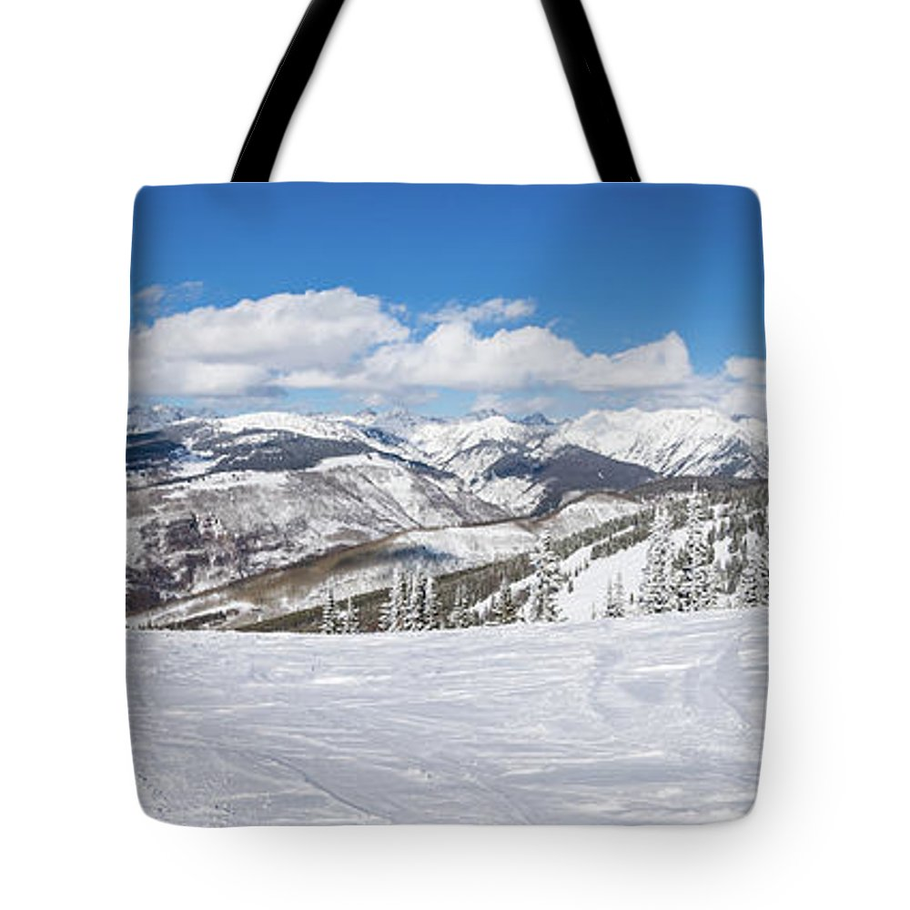 Scenics Tote Bag featuring the photograph Forest Covered By Snow With Skiing by Miralex