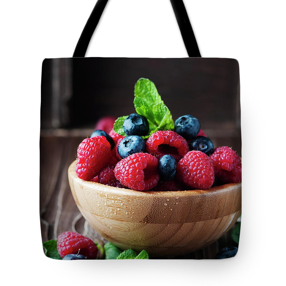 Vitamin Tote Bag featuring the photograph Fresh Sweet Raspberry And Bluberry by Oxana Denezhkina