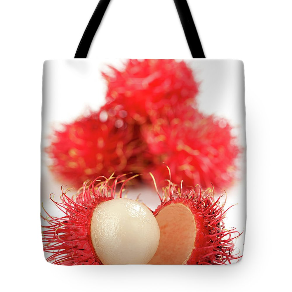 Raw Food Diet Tote Bag featuring the photograph Fresh Thai Rambutans by Enviromantic