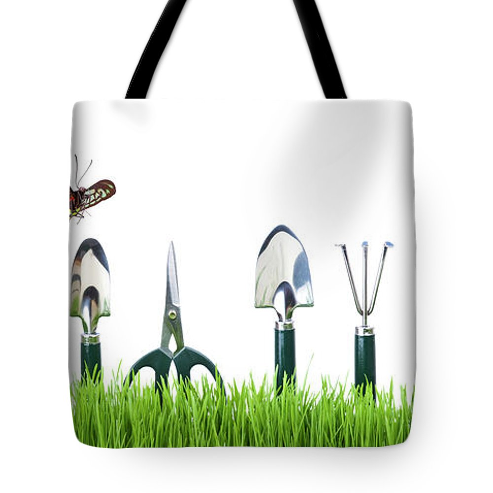 Grass Tote Bag featuring the photograph Garden Tools by Liliboas