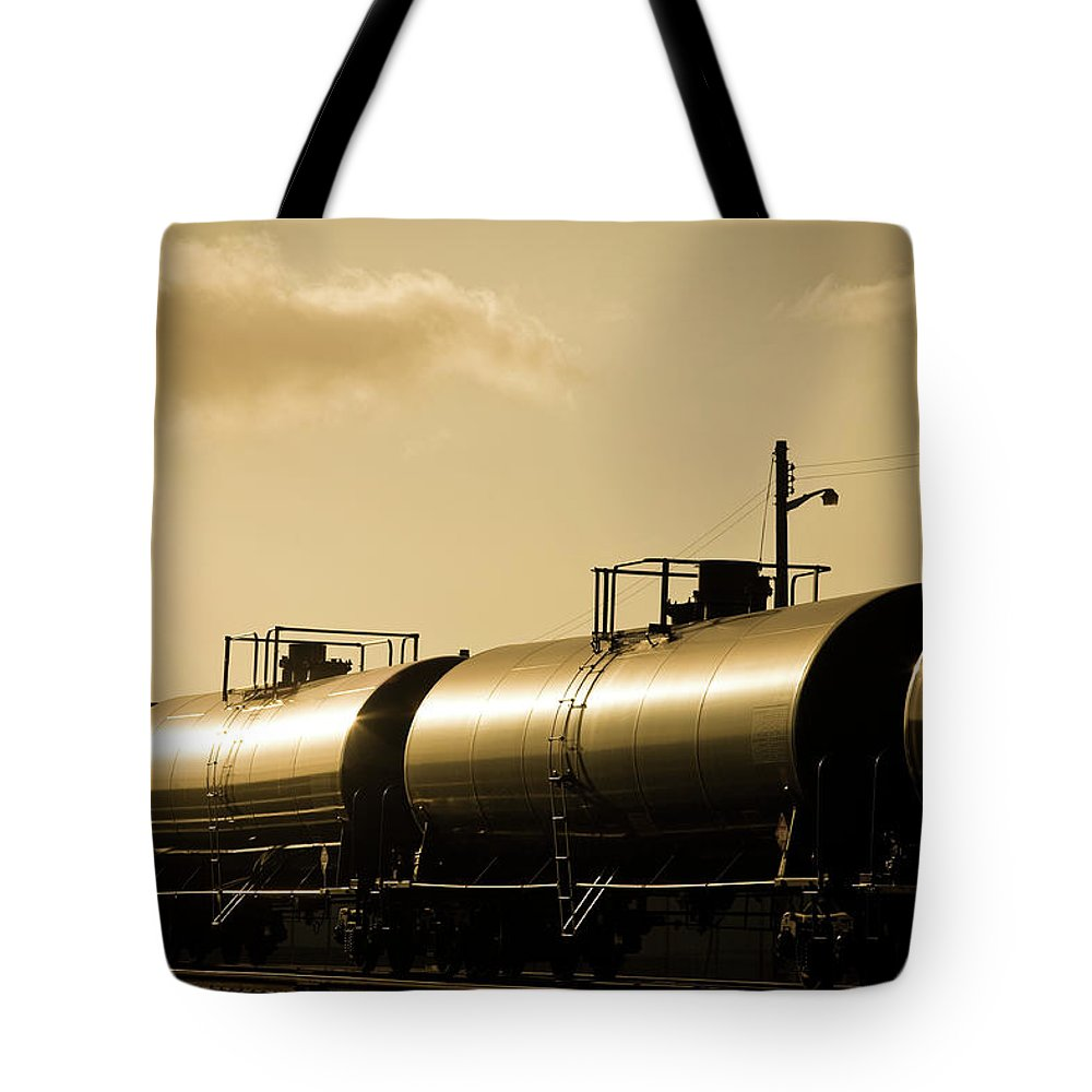 Natural Gas Tote Bag featuring the photograph Gasoline Train At Sunset by Halbergman