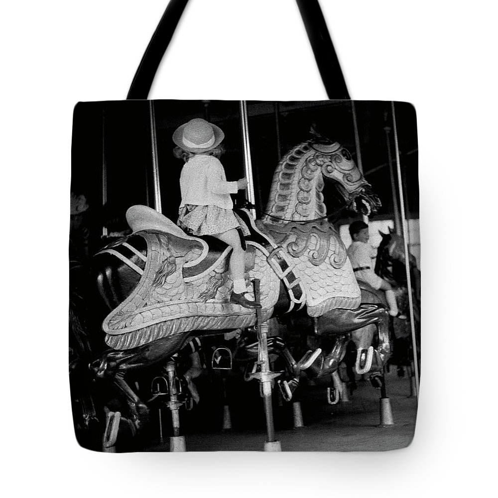 Child Tote Bag featuring the photograph Girl Riding A Carousel by George Marks