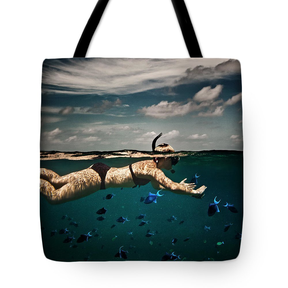 People Tote Bag featuring the photograph Girl Snorkelling In Indian Ocean by Rjw