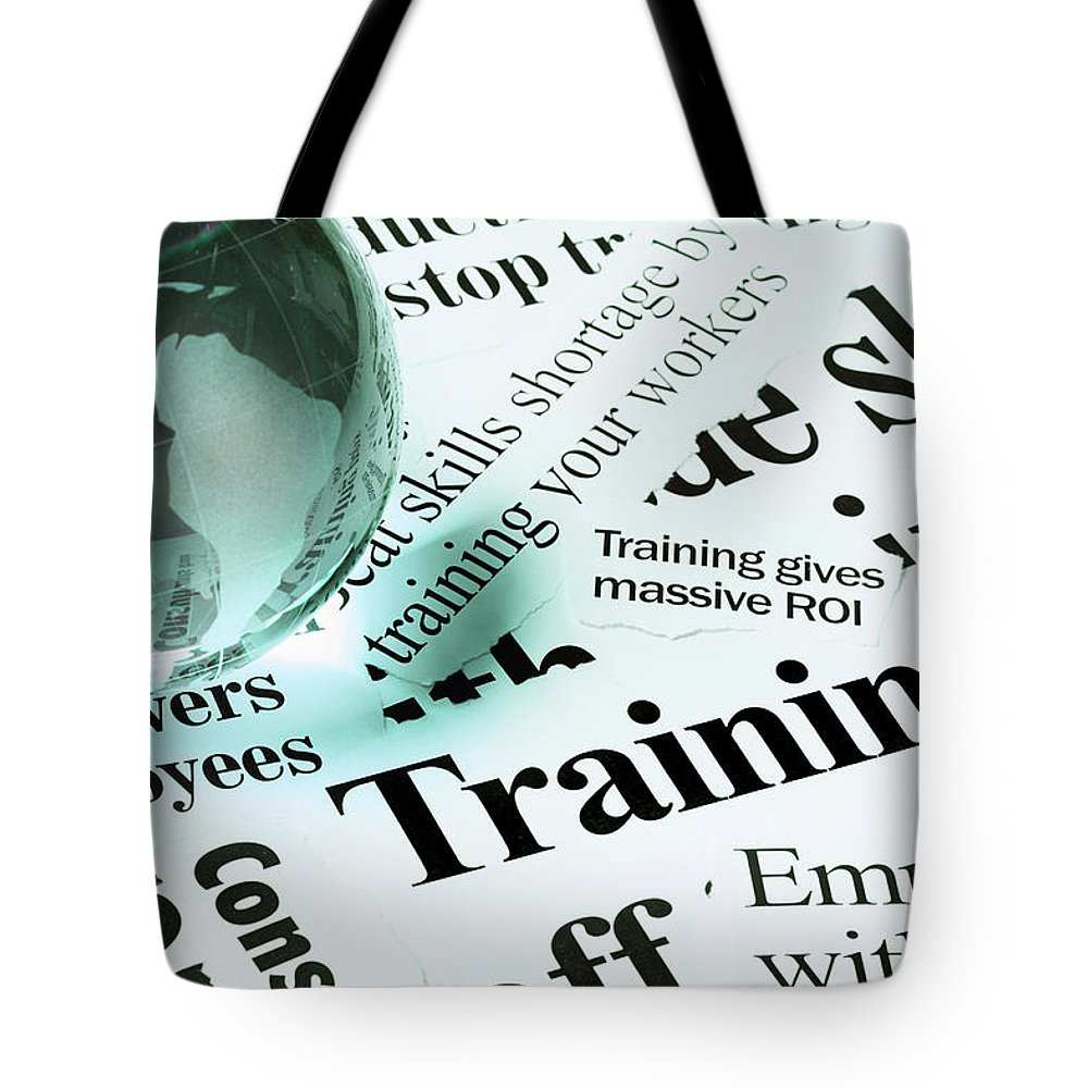 Employment And Labor Tote Bag featuring the photograph Glass Globe Paperweight On Headlines by Rapideye