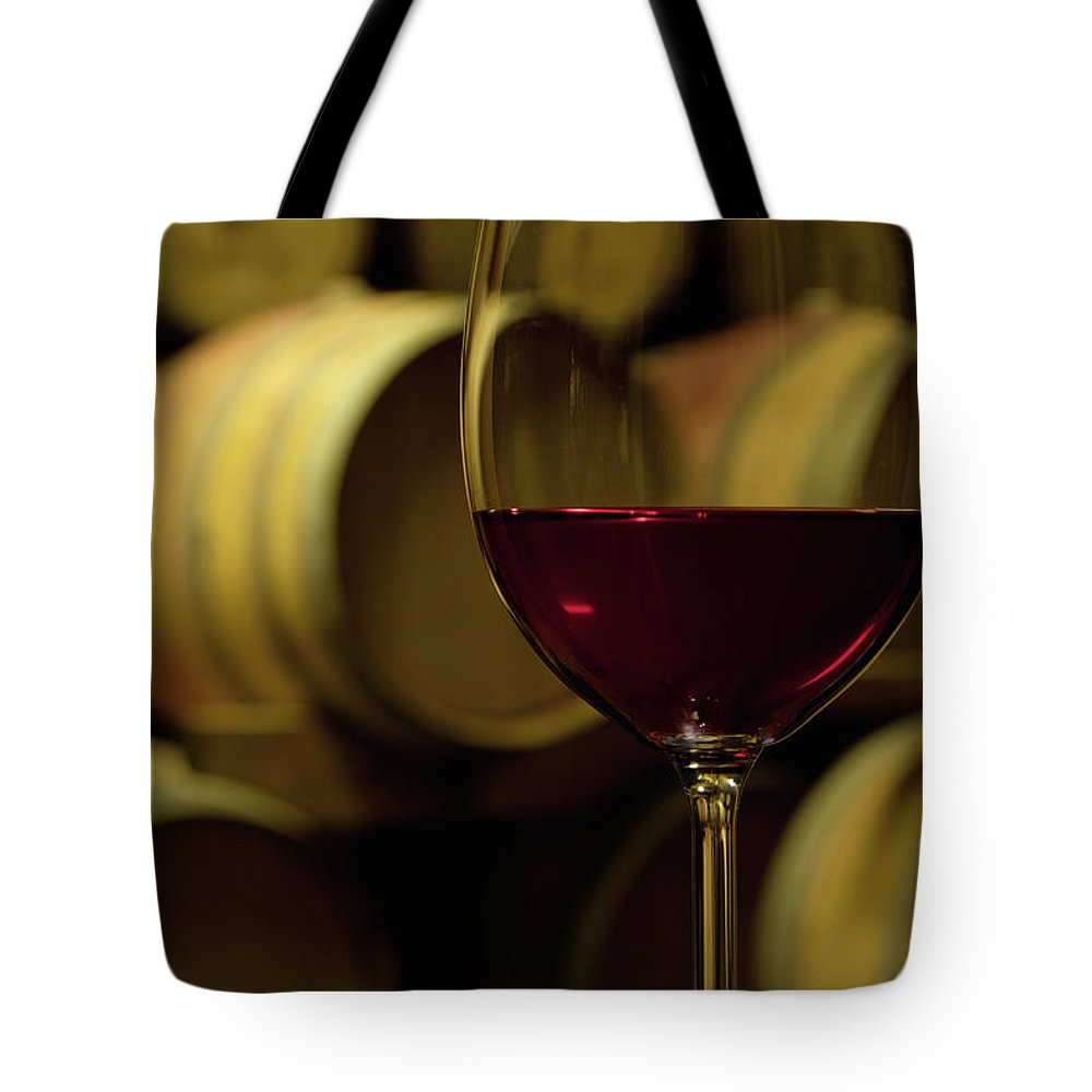 Stellenbosch Tote Bag featuring the photograph Glass Of Red Wine In Wine Cellar by Siegfried Layda
