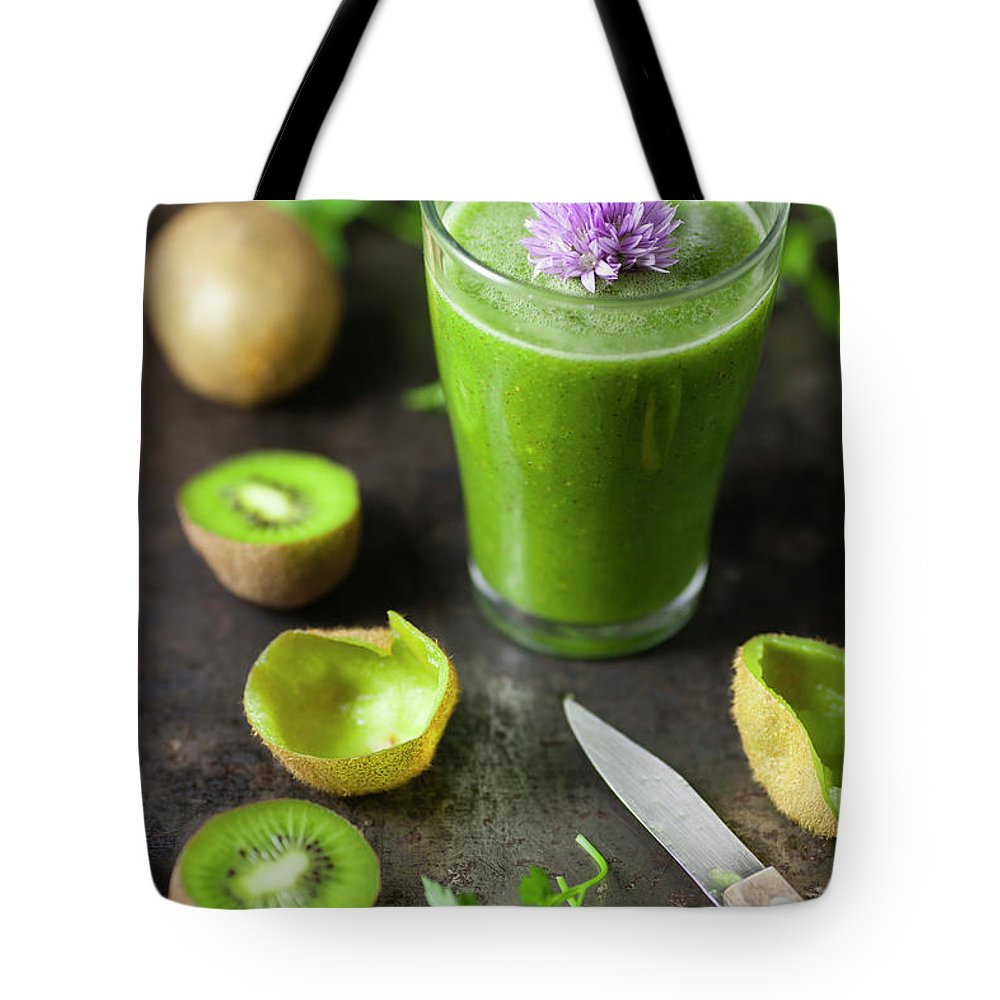 Cutting Board Tote Bag featuring the photograph Glass Of Smoothie With Kiwi, Parsley by Westend61