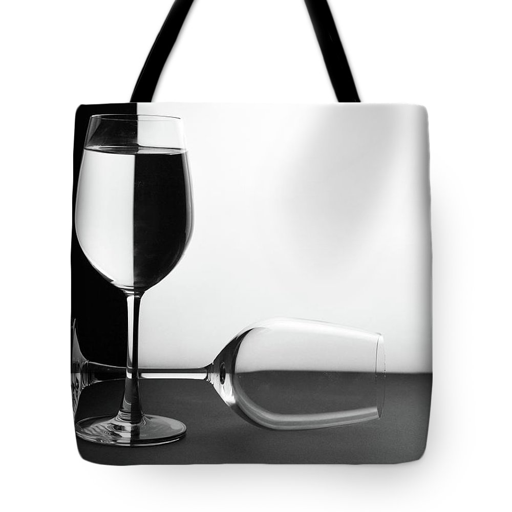 Alcohol Tote Bag featuring the photograph Glasses by Photo By Bhaskar Dutta