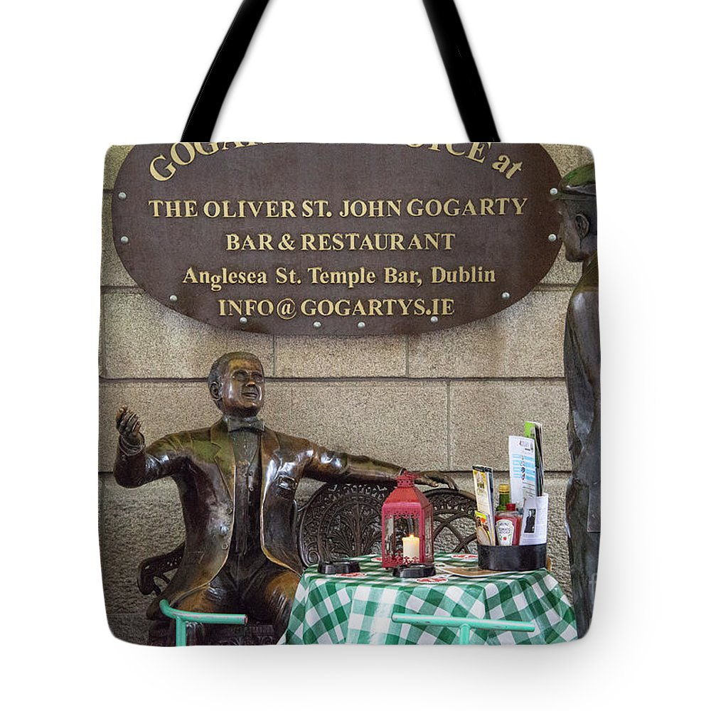 Dublin Tote Bag featuring the photograph Gogarty And Joyce Statues One by Bob Phillips