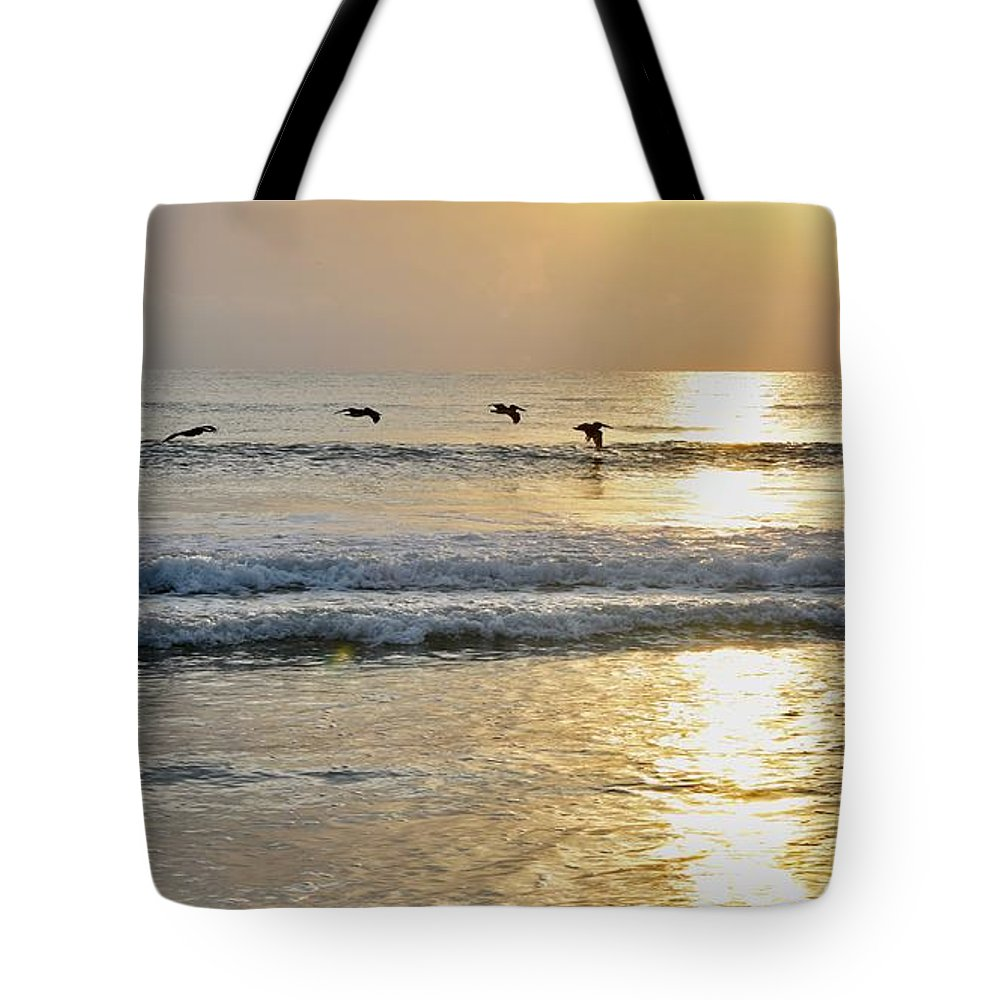 Ocean Sunrise Tote Bag featuring the photograph Golden Daybreak by Laurie Hein