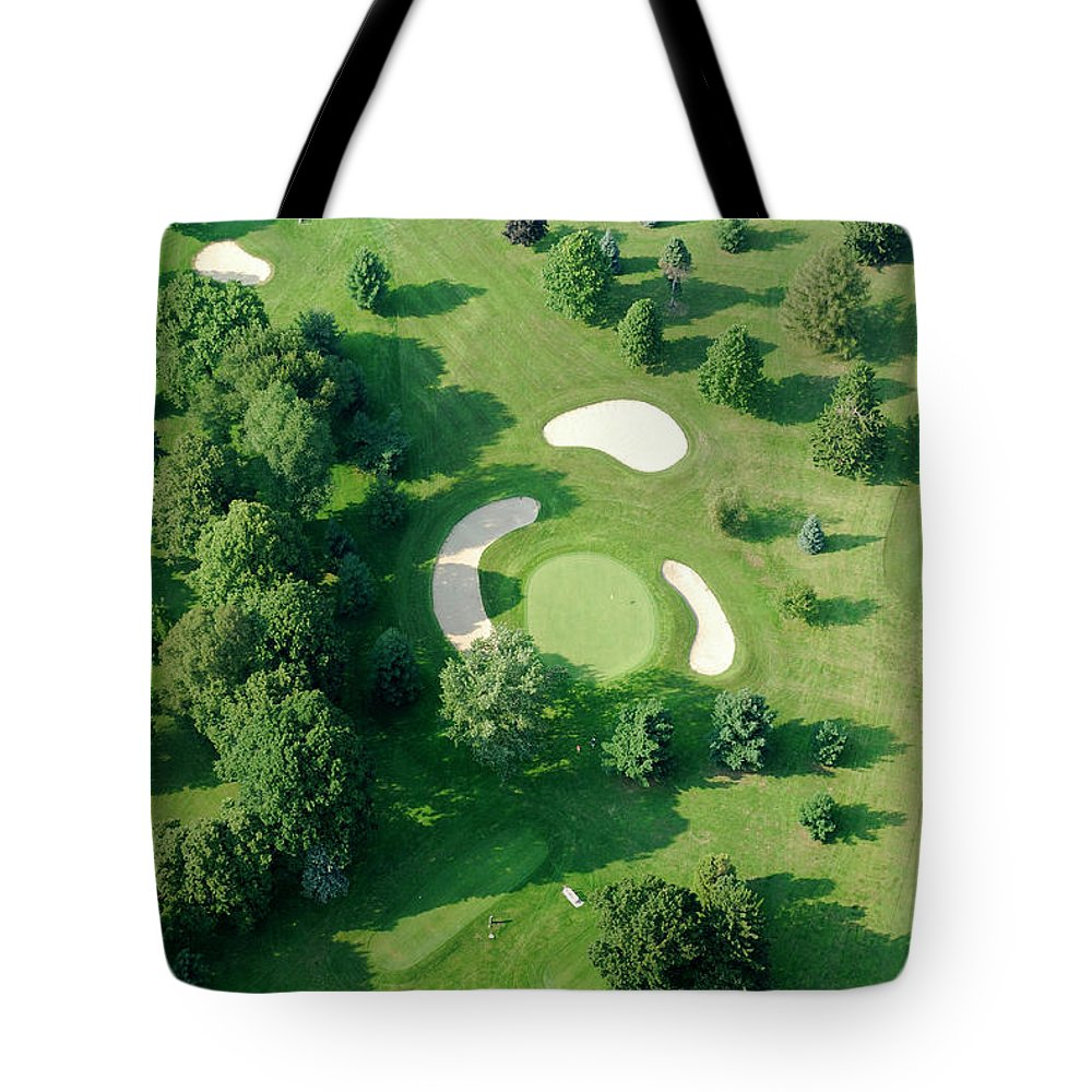 Sand Trap Tote Bag featuring the photograph Golf Course Close Up From The Air by Groveb