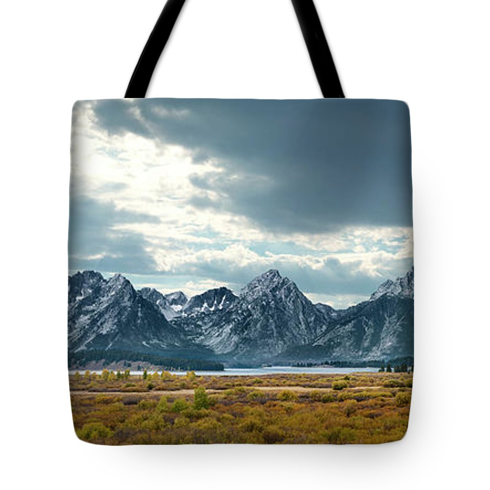 Scenics Tote Bag featuring the photograph Grand Tetons In Dramatic Light by Ed Freeman
