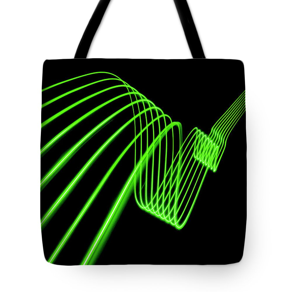 Laser Tote Bag featuring the photograph Green Abstract Coloured Lights Trails by John Rensten
