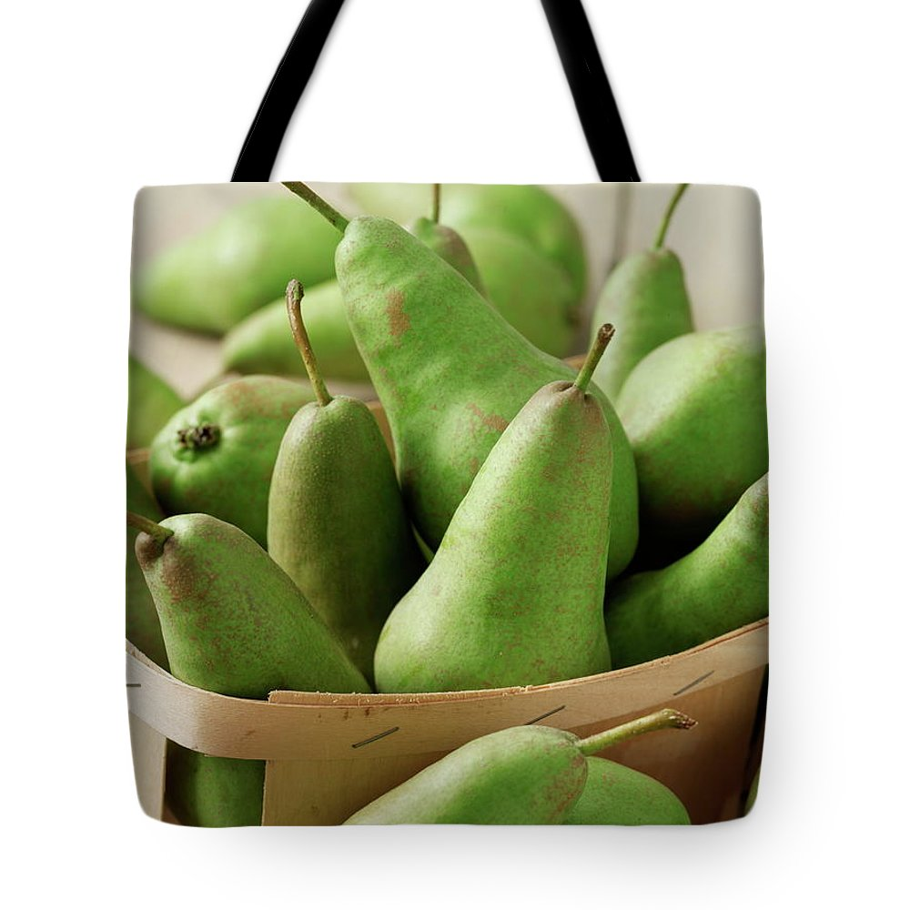Fruit Carton Tote Bag featuring the photograph Green Pears In Punnet And Wooden Table by Chris Ted