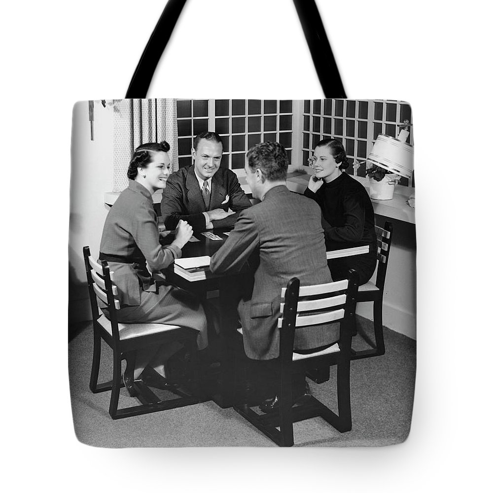 Heterosexual Couple Tote Bag featuring the photograph Group At A Table by George Marks