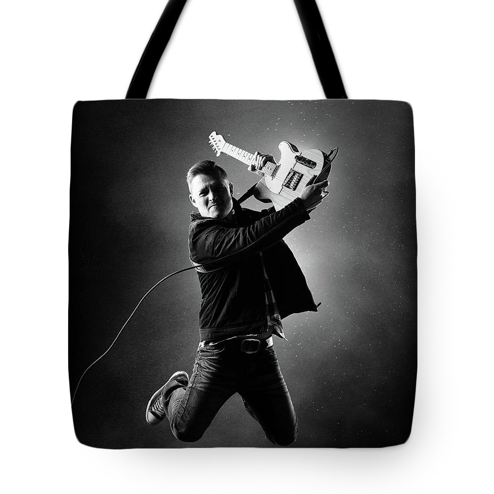 Jumping Photographs Tote Bags